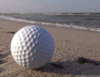 Golf ball on beach
