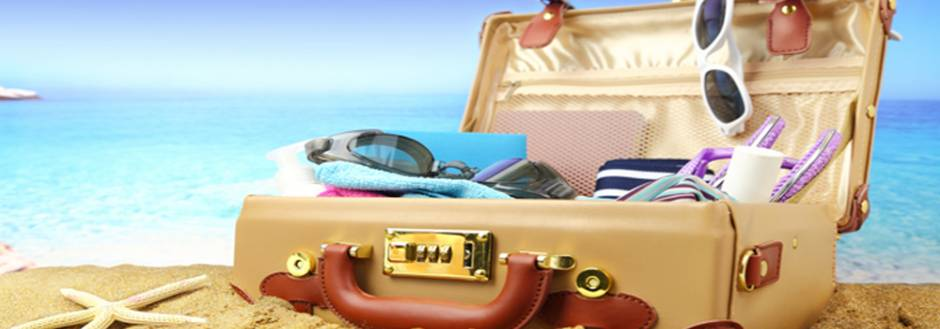 Packed Suit Case on the beach