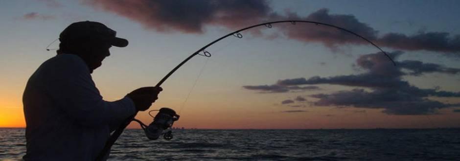 Man fishing at dawn