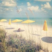 Beach with yellow umbrellas and chairs