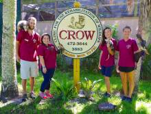 C.R.O.W. staff in front of sign