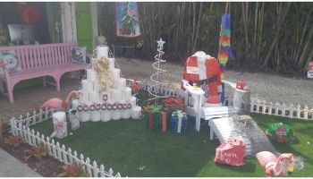 """A TP """"Quarantree"""" with a spray bottle of """"Santa-tizer."""""""